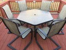 Patio furniture with umbrella base and new umbrella in Camp Lejeune, North Carolina