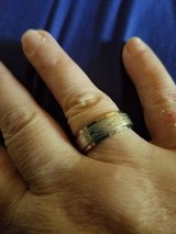 Man's wedding ring not sure of metal outside spins size 9 in Camp Lejeune, North Carolina