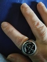 Man or woman's  ring with an anchor on it stainless size 10 to 10.5 I think in Camp Lejeune, North Carolina