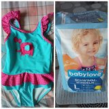 Baby swimsuit (Ernsting's Family) + free diapers in Stuttgart, GE