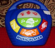 S. Blue Music Player. Plays different instruments in Alamogordo, New Mexico