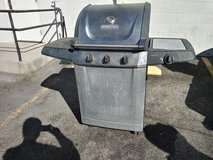 Stainless steel BBQ with side burner and propane tank in Nellis AFB, Nevada