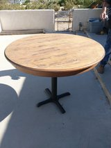solid wood table with cast iron base in 29 Palms, California