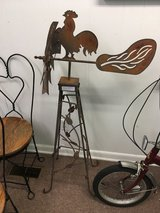 Antique wrought iron rooster weathervane windmill in Beaufort, South Carolina