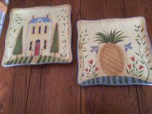Hanging plates with one pineapple hospitality and the other home sweet home image in Wilmington, North Carolina