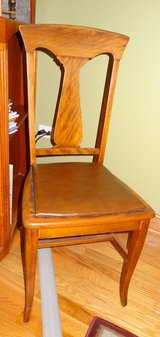 Wood chair with padded seat in Yorkville, Illinois
