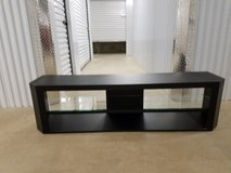 Large TV stand with glass shelve in middle in Lackland AFB, Texas