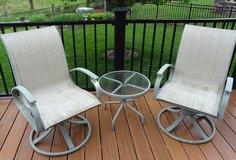 (2) swivel patio chairs with table in Yorkville, Illinois