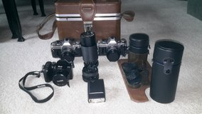 2 AE-1 cameras, extra lens, flash, Kodak camera,case in Joliet, Illinois