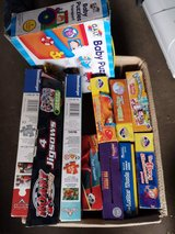 box of kids puzzles in Lakenheath, UK