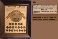 war time coins in frame WWII in Fort Polk, Louisiana