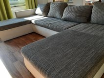 U shape couch with pull out bed function and storage in Ramstein, Germany