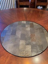 Pub table and chairs with built-in last susan in Naperville, Illinois