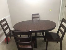 solid wood dining table with 4 chairs in Columbus, Georgia