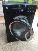 Black lg front loading washer and dryer in Houston, Texas