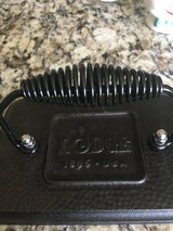 Lodge Cast Iron Grill Press Set of 2, Like New, size 6 3/4 x 4 1/2 inch each in Camp Lejeune, North Carolina