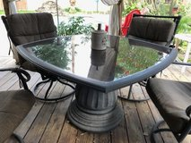 Patio table and four rotating chairs in Kingwood, Texas