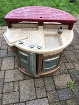 Step 2 outdoor kitchen with 2 seats to eat at in Joliet, Illinois