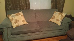 Couch with throw pillows in Fort Leonard Wood, Missouri