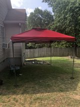 10x10 Red Canopy with weights in Macon, Georgia