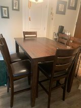 Table and 8 Chairs in Joliet, Illinois