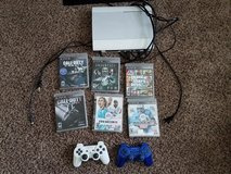 PS3 with games and controllers in Fort Campbell, Kentucky