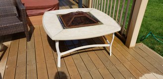 Outdoor fire pit chat table in Joliet, Illinois