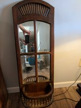 Older wall mirror and shelf in 29 Palms, California