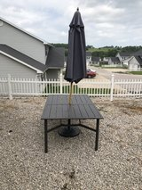 Outside metal patio set w/ umbrella and base in Fort Leonard Wood, Missouri