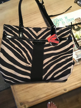 Coach zebra tote purse with matching makeup bag and black sig wristlet in Travis AFB, California