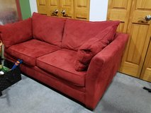 Red microfiber queen-sized sleeper sofa couch in Shorewood, Illinois
