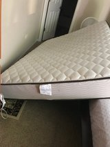 Queen mattress with box spring and iron frame in Naperville, Illinois