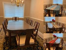 Solid wood dining table with 8 chairs 2 leaves in Naperville, Illinois