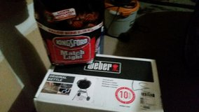 weber grill 22 inch still in box never opened   with a 15# bag of charcoal included in Bartlett, Illinois