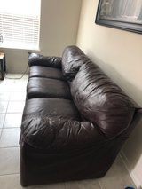 Maroon Leather Couch in Kingwood, Texas