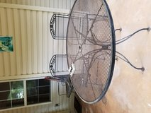Black wrought iron patio set. 48 inch round table with 2 spring back chairs and 2 rocking chairs... in Perry, Georgia