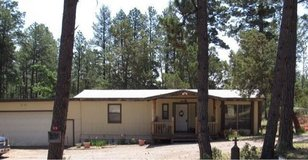 2bd 2bath manufactured home on 1.5+ Commercial acres 2 sheds attached 2 car garage plus more! in El Paso, Texas