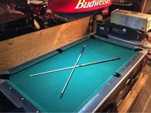 Pool Table with light and accessories in Kingwood, Texas