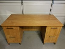 brown wooden twin-pedestal desk in Camp Pendleton, California