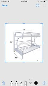 white metal bunk bed. Twin on top and full size on bottom in Plainfield, Illinois