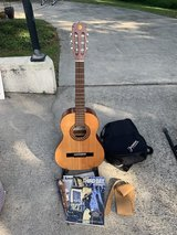 Jasmine nylon string guitar with stand and tablature. in Beaufort, South Carolina