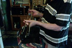 2 violin bows, one long one shorter in Aurora, Illinois