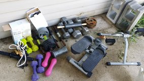 Weights and other exercise gear lot in Fort Leonard Wood, Missouri