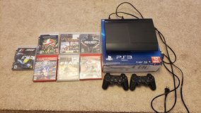 Playstation 3 with games 2 controllers. in Barstow, California