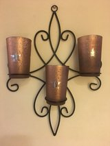 Metal candle holder wall decor in Okinawa, Japan