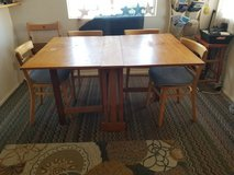 Danish modern collapsible wooden table and four wooden chairs in 29 Palms, California