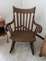 Antique vintage solid wood rocking chair in Wheaton, Illinois