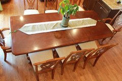 Cherry dining table with 8 chairs in good condition in Naperville, Illinois