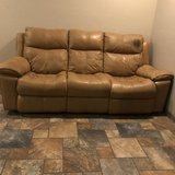 Leather sofa, 2 working electric recliners on either end. Light tan. It has a dark stain on one ... in Alamogordo, New Mexico