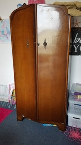 FREE antique shrunk. One side has shelves on the inside the other side a rod for hanging clothes in Stuttgart, GE